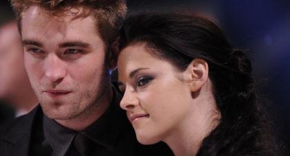 Robert Pattison seen having a gala time with Sean Penn's daughter